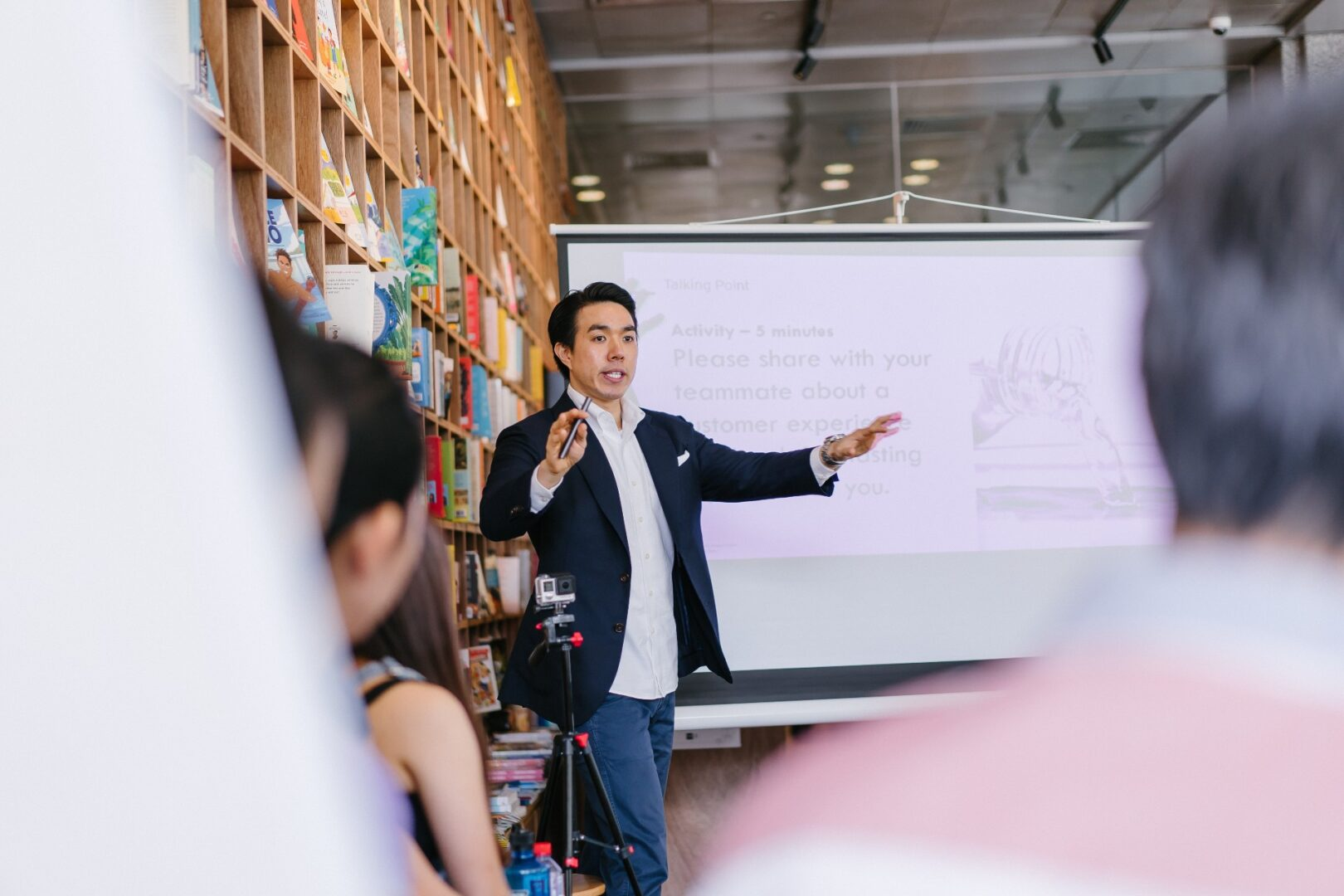 Asian business man presenting to a group of audience members